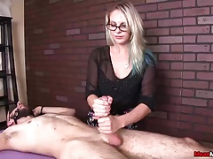 Sexy blonde babe jerks off the tied man