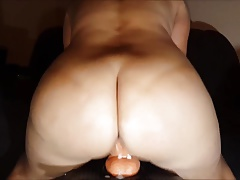 Big ass sits on rubber dick