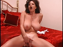 A brunette milf with an awesome pair of tits lets them hang for the camera
