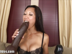 Busty asian rides a massive brown brutal dildo
